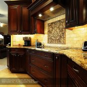 Kitchen with dark custom cabinets, countertops, and backsplash - St Croix Cabinet Solutions