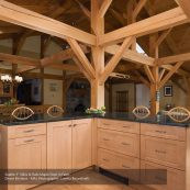 Open kitchen and dining room with maple custom cabinets and ceiling beams - St Croix Cabinet Solutions