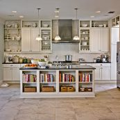 Kitchen with white custom cabinets and open shelving and dark countertops - St Croix Cabinet Solutions