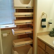 Custom bathroom storage with pull-out drawers - St Croix Cabinet Solutions