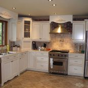 Updated kitchen with white custom cabinets and tile floor - St Croix Cabinet Solutions