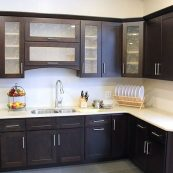 Kitchen with dark custom cabinets and white countertops - St Croix Cabinet Solutions