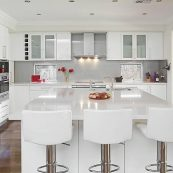 Bright kitchen with modern white cabinets and white countertops - St Croix Cabinet Solutions