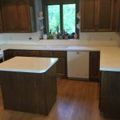 Kitchen with white countertops and dark custom cabinets - St Croix Cabinet Solutions