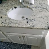 Modern bathroom vanity with stone countertop - St Croix Cabinet Solutions