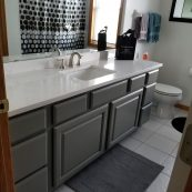 Bathroom with gray cabinets and updated white countertops - St Croix Cabinet Solutions