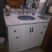 Bathroom vanity with white cabinet and gray countertop - St Croix Cabinet Solutions