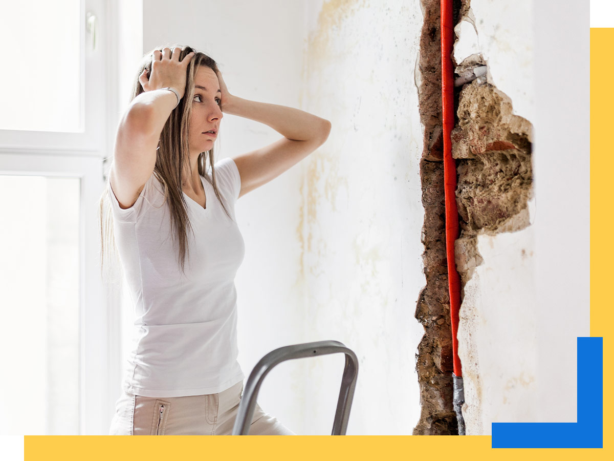 A woman discovers water damage in her walls.