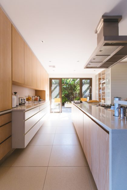An image of a home, with a view from the inside of the kitchen.