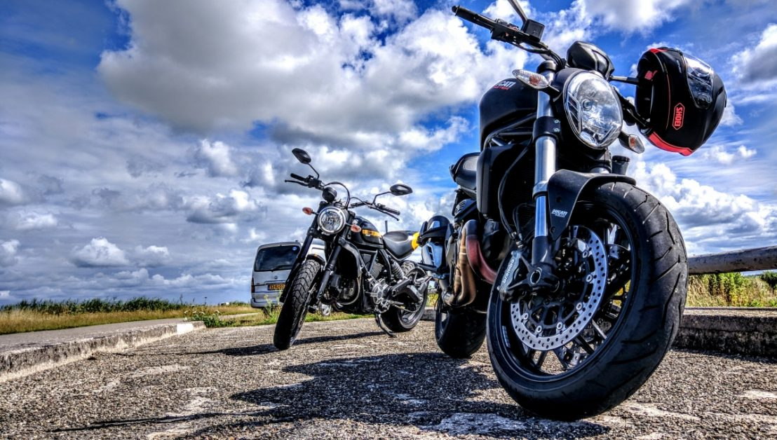 Motorcycles parked on the side of the road