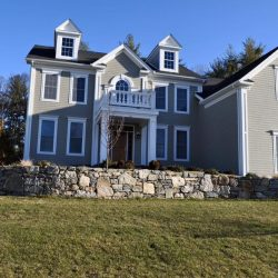 This stone wall is a perfect touch to this Walpole home