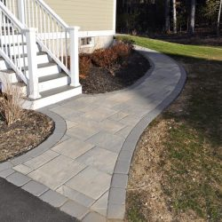 An immaculate stone walkway by StonePro Builders in Walpole