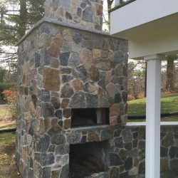 In need of a stunning stone fireplace like this one? StonePro Builders can help