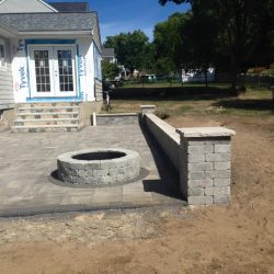 The beginning of a stone fireplace in Walpole that is sure to look great