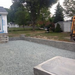 Stone steps, a wall, and a patio by StonePro Builders is looking pretty great