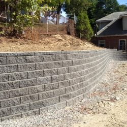 Construction of a stone wall in Walpole by StonePro Builders