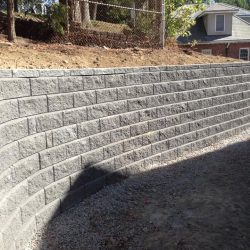 A symmetric grey stone wall in Walpole by StonePro Builders