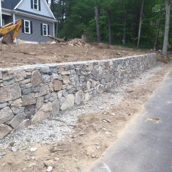 A beautiful wall designed and constructed by StonePro Builders in Walpole