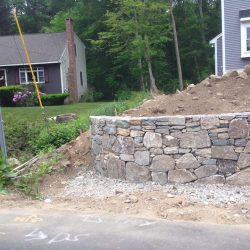 This exterior stone wall in Walpole already looks gorgeous