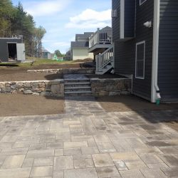 A stone patio and steps in Walpole under construction