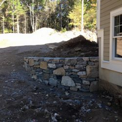 Expert construction of a stone wall by StonePro Builders in Walpole