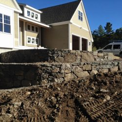 Want a stone wall like this one under construction? StonePro in Walpole can help