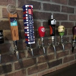 Image of Tap Handles Along Wall in Studebaker Pub