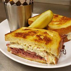 Image of Studebaker Steak Sandwich and Accompanying Fries