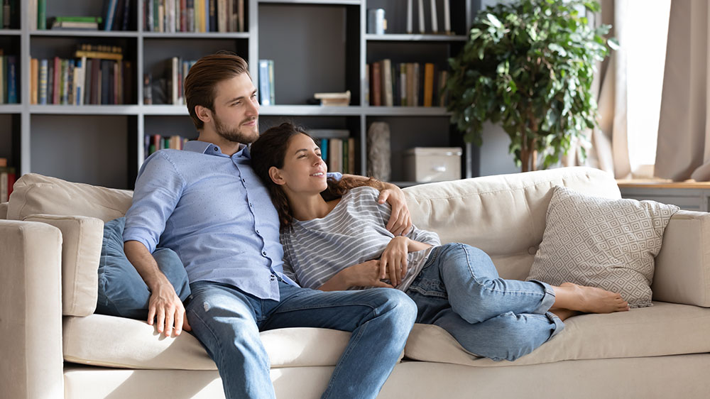 Couple laying on a couch relaxing