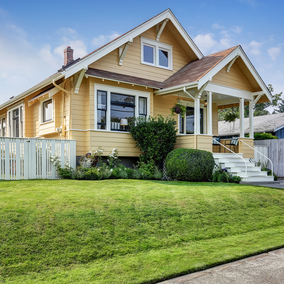 Gorgeous home with a well-maintained lawn and exterior.