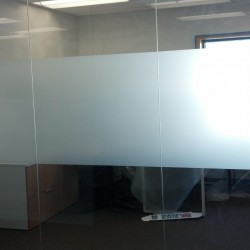Commercial decorative window tinting installation of white frost.