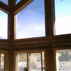 Residential window tinting service at a Colorado mountain home.