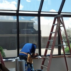 Colorado commercial window tinting service in progress.