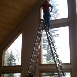 SunGlo Window Films installation technician hard at work on a tall ladder!