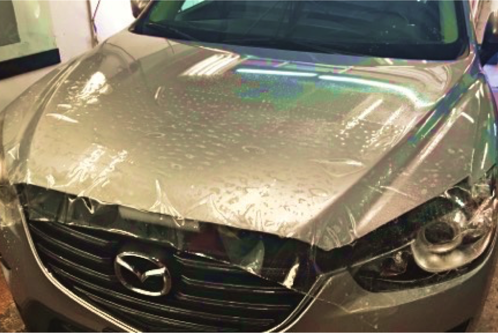 Clear Bra being applied in Denver to a 2016 Mazda CX-5.