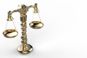 scales of justice rendered in gold against white background