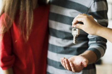 couple being handed keys to their new home
