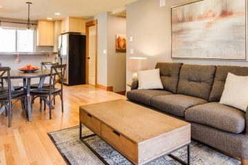 Beautifully staged living room and kitchen area