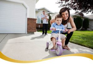Family In Driveway_shutterstock_90228532_web_swoosh