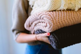 An image of a person holding blankets.
