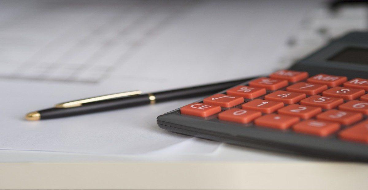 A mathematics calculator and a pen