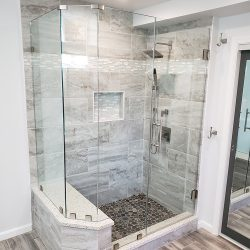 Grey and white tile shower with custom glass shower doors