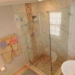 Glass shower doors with custom tile