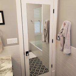 Custom mirror and custom glass shower door
