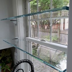 Custom glass shelving for a kitchen