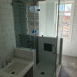 Maryland glass shower doors with black and white tile