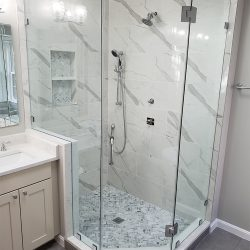 Clear glass shower doors with grey and white marble