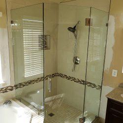 Custom glass shower doors with white tile