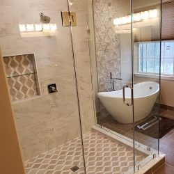 Custom glass shower doors with gold features