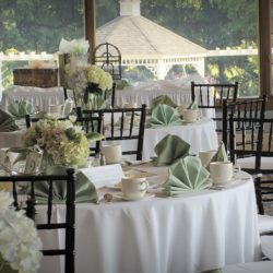 Wedding reception tables with white table clothes and black Chiavari chairs - The Rented Event